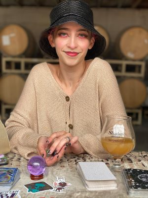 Activities like tarot readings by Kiera Montana (pictured) are available at the weekly Shades Brewing art events.
