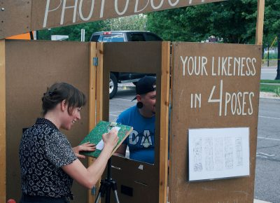 In between sets, the audience checks out the many local artisans such as the Hand Drawn Photo Booth.