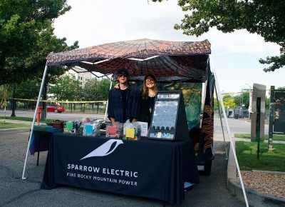 Sparrow Electric showing off their booth at the SLUG Picnic.