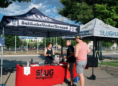 Attendees sign up for the SLUG Picnic raffle for a chance to get exciting gifts from the event's sponsors.
