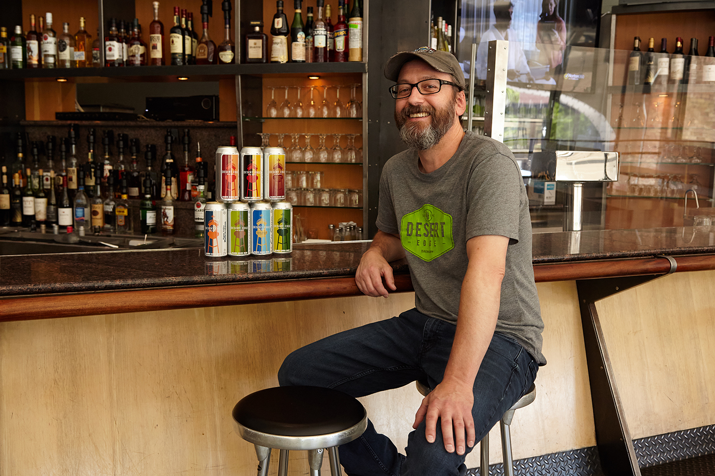 Desert Edge Head Brewer Chad Krusell embraces the recent, small but mighty hand-canning operation at the brewery that now sees Desert Edge brews to go.