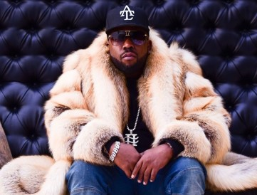 A picture of Big Boi in a fur coat looking good.