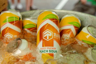 RoHa Brewing Project's refreshing Fuzzy Pucker Peach Sour floats in a bath of ice.