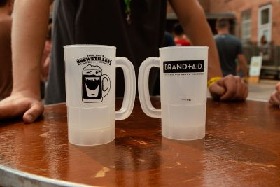 The distinctive clear plastic mugs housed the many pours at the Brewstillery festival.