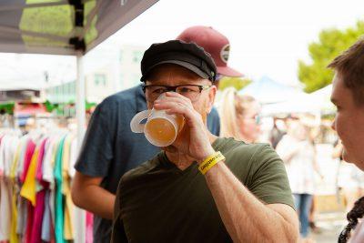 A satisfied Brewstillery attendee sips on their sample.