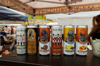 Five Wives Vodka displays their new line of canned cocktails.
