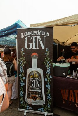 A floral advertisment for Waterpocket Distillery's Temple of the Moon Gin.