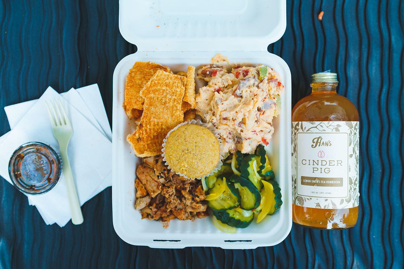 Cinder Pig's Pork Plate has all the fixings for a filling meal. Paired with their Han's Kombucha collaboration, this meal really hits the spot!