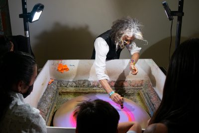 Wayne Coyne makes spin art with patrons of his immersive art experience, The King's Mouth.