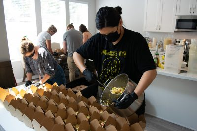 Food Justice Coalition Founder Jeanette Padilla and FJC volunteers prepare plant-based meals for unsheltered citizens of SLC.