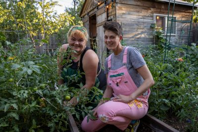 (L–R) Nico and Nat Dicou offer locally grown foods such as tomatoes and jelly melon cucumbers at their urban farm, Lincoln Street Farm.