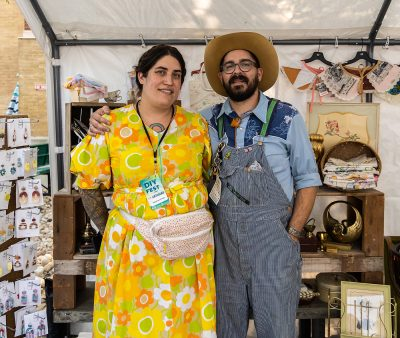 Jacqueline and Logan Whitmore of Copperhive Vintage enjoying a little shade in the comfort of their booth.