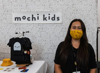 Mochi Kids owner displays some of their wares.
