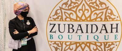 Zubaidah Sadeq stands proudly next to her booth.