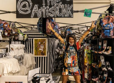 Chrissy Noel Kinslow of CNK Designs rocking out at her booth.