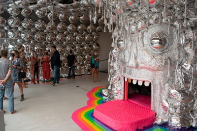 The King's Mouth is a hands-on exhibit in which participants climb into the art piece itself to explore a sensory light show.