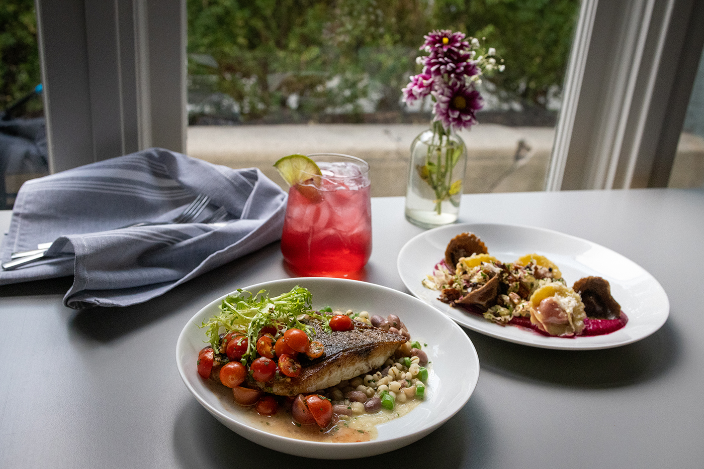 (L–R) Arlo's Sea Bass, Spritzer and Ravioli carry complementary elements that make for successful entrée pairings.