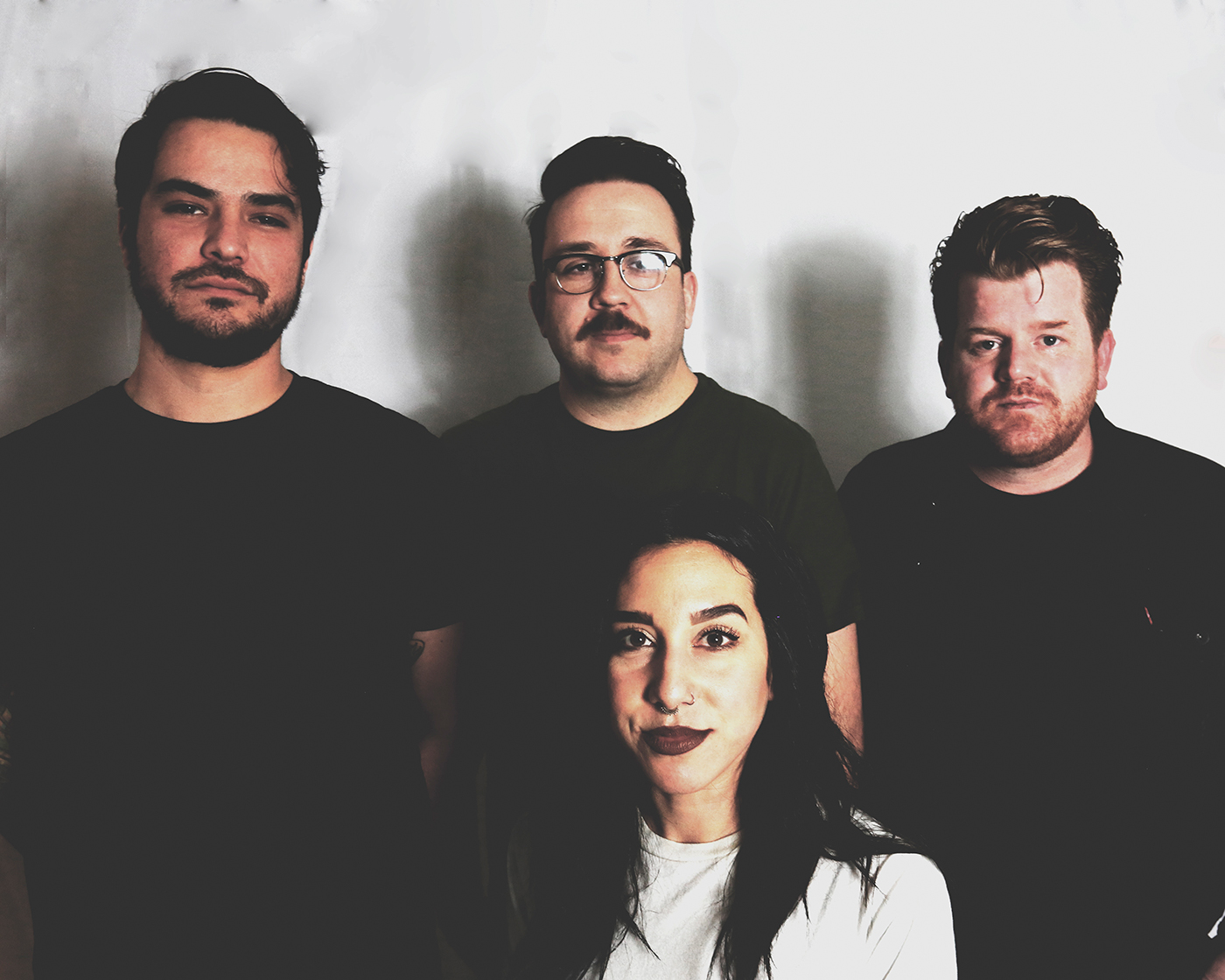 (Clockwise from left) City Ghost members Matt Mascarenas, Ken Vallejos, Chase Griffis and Sadie O'Neill merge their unique musical pasts together for their own, identifiable noise.
