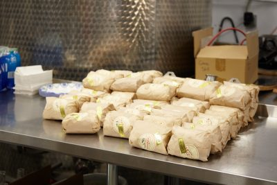 A generous helping of handcrafted sandwiches from Caputo's Deli for arriving guests.